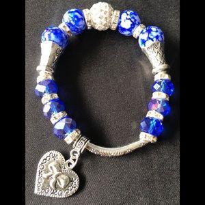 NWOT Charm/Beaded stretchy Bracelet